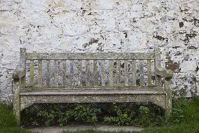 A Wooden Bench With Peeling Paint Art Print by John Short