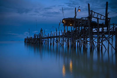 A Wooden Pier With Lights On It At Art Print by David DuChemin
