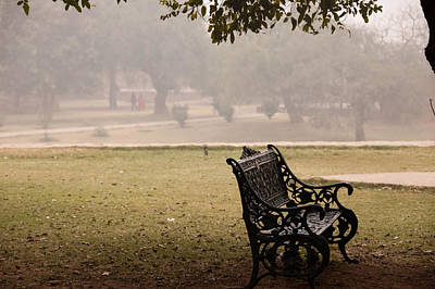 A Wrought Iron Black Metal Bench Under A Tree In The Qutub Minar Compound Art Print by Ashish Agarwal
