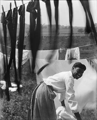 Over The Shoulder Photograph - A Young African American Woman Working by Everett