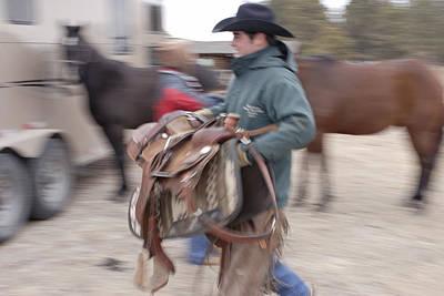 A Young Rancher Lifts A Art Print by Joel Sartore