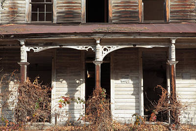 Photograph - Abandoned House Facade Rusty Porch Roof by John Stephens