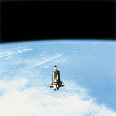 Aerial View Of The Space Shuttle In Orbit Above Earth Print by Stockbyte