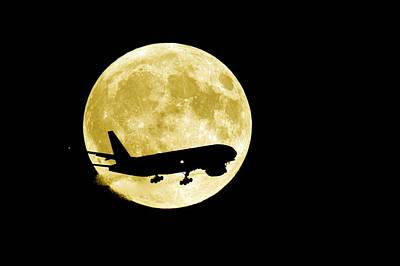 Aeroplane Silhouetted Against A Full Moon Art Print by David Nunuk