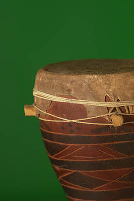 Colored Background Photograph - African Drum On Green Backgound by Philip Haynes