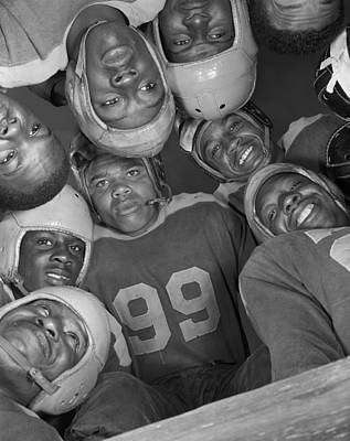 Africans American Football Huddle Print by Everett