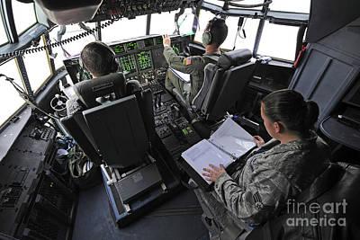 Aircrew Perform Preflight Checklists Print by Stocktrek Images