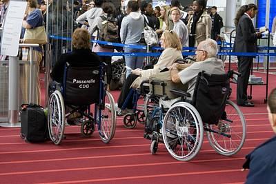 Airline Passengers In Wheelchairs Art Print