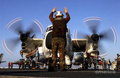 C-2 Greyhound Photograph - Airmam Instructs The Pilots Of A C-2a by Stocktrek Images