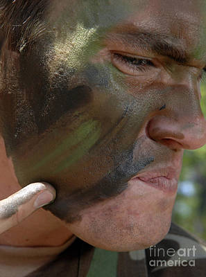 Airman Applies War Paint To His Face Art Print by Stocktrek Images
