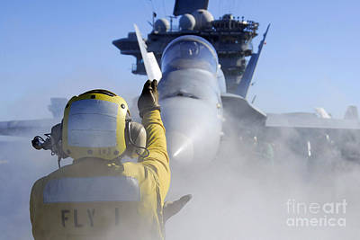 Patriotic Signs - Airman Directs An Fa-18 Hornet by Stocktrek Images