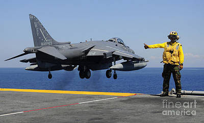 Nirvana - Airman Gives The Thumbs-up Signal As An by Stocktrek Images