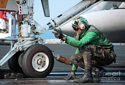 Airman Guides An Fa-18 Hornet Onto Art Print