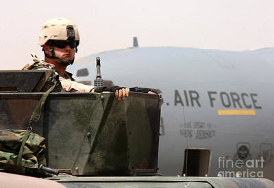 Airman Mans The Turret Atop A Humvee Art Print by Stocktrek Images