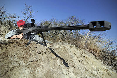 Down On The Ground Photograph - Airman Sights A .50 Caliber Sniper by Stocktrek Images
