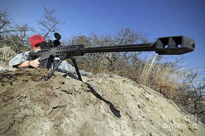 Airman Sights A .50 Caliber Sniper Art Print by Stocktrek Images