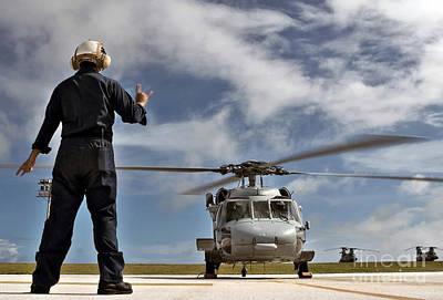Airman Signals The Pilot Of An Mh-60s Art Print by Stocktrek Images