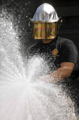 Obscured Face Photograph - Airman Tests A Water Pump Truck by Stocktrek Images
