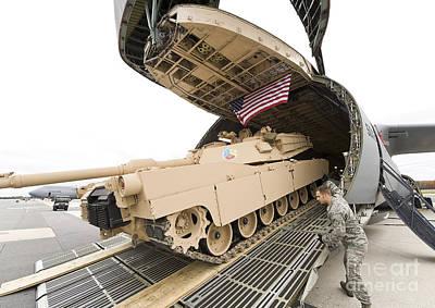 Battle Tank Photograph - Airmen Load A Tank Into A C-5m Super by Stocktrek Images