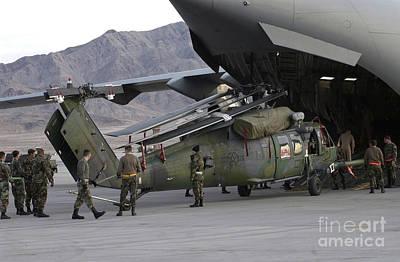 Airmen Load An Hh-60 Pave Hawk Art Print