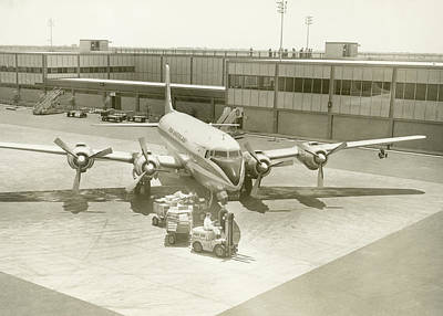 Airplane And Ground Crew On Airport Art Print by George Marks