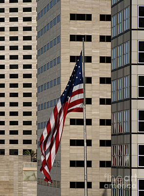 United States Of America Photograph - American Flag In The City by Blink Images