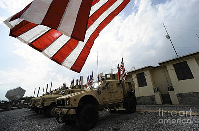 Independence Mine Photograph - American Flags Are Displayed by Stocktrek Images