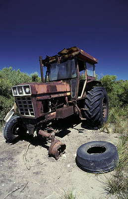 An Abandoned Tractor Rusts Away Art Print by Jason Edwards