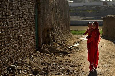 An Afghan Girl Carries Her Little Art Print by Stocktrek Images