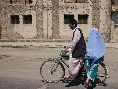 An Afghani Couple Rides A Bicycle Art Print by Everett