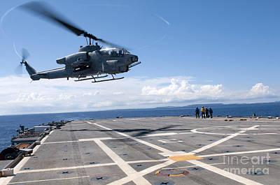 An Ah-1w Super Cobra Helicopter Lands Art Print by Stocktrek Images