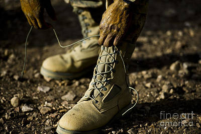 Tying Shoe Photograph - An Air Force Basic Military Training by Stocktrek Images