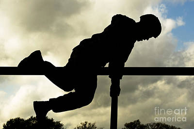 Pineapple - An Airman Scales An Obstacle At Camp by Stocktrek Images