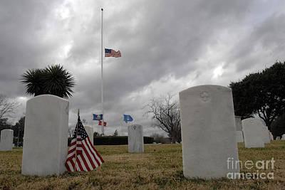 An American Flag Flies At Half Staff Art Print by Stocktrek Images