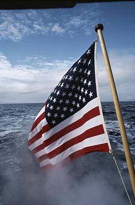 Neah Bay Photograph - An American Flag Flutters From The Back by Sam Abell