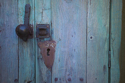 Turquoise And Rust Photograph - An Antique Lock On A by Raul Touzon
