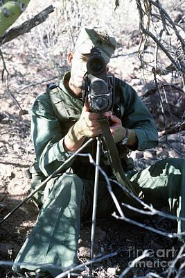 An Army Ranger Sets Up An Anpaq-1 Laser Art Print by Stocktrek Images