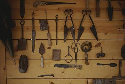 Etc. Photograph - An Assortment Of Hand Tools Hang by Raul Touzon