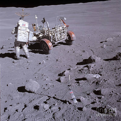 An Astronaut And A Lunar Roving Vehicle Art Print by Stocktrek Images