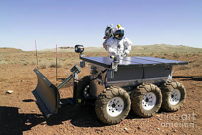 Photograph - An Astronaut Drives An Electric Tractor by Stocktrek Images