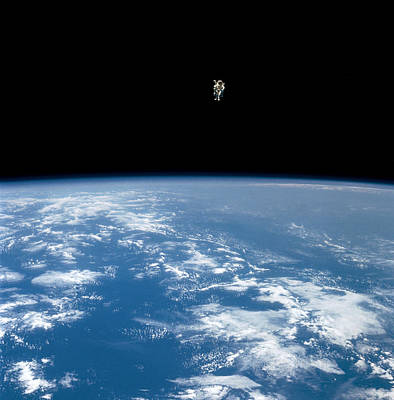 An Astronaut Propelled Above The Earth Art Print by Nasa