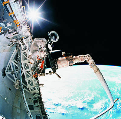Space Ships Photograph - An Astronaut Working In Space by Stockbyte