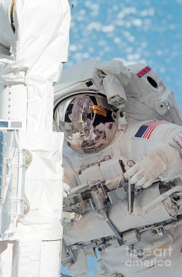 Photograph - An Astronaut Works On A Session by Stocktrek Images