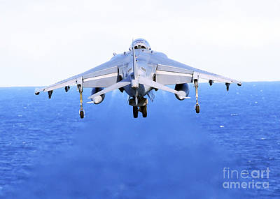 An Av-8b Harrier Jet Launches Art Print by Stocktrek Images