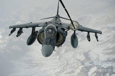 An Av-8b Harrier Receives Fuel Art Print by Stocktrek Images