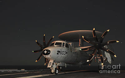An E-2c Hawkeye Is Chained Art Print by Stocktrek Images