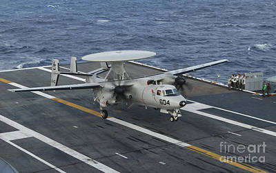 Photograph - An E-2c Hawkeye Is Recovered by Stocktrek Images