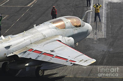 Prowler Photograph - An Ea-6b Prowler Is Guided Onto by Giovanni Colla