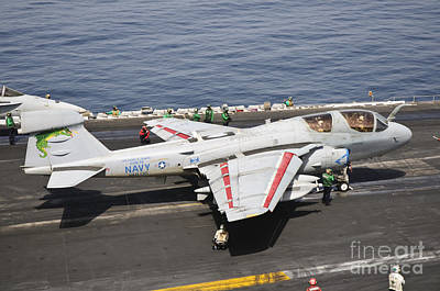 Naval Aircraft Photograph - An Ea-6b Prowler Is Ready To Go by Giovanni Colla