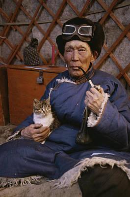 Elderly People Photograph - An Elderly Mongolian Man Relaxes by Gordon Wiltsie